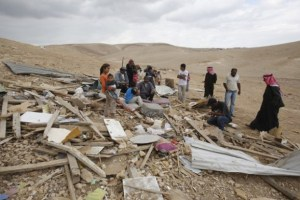 Palestinian Bedouins shift through their