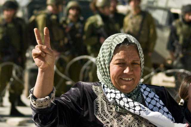 A village woman at the weekly protest against the occupation in Al Ma'sara, West Bank (January 2010)